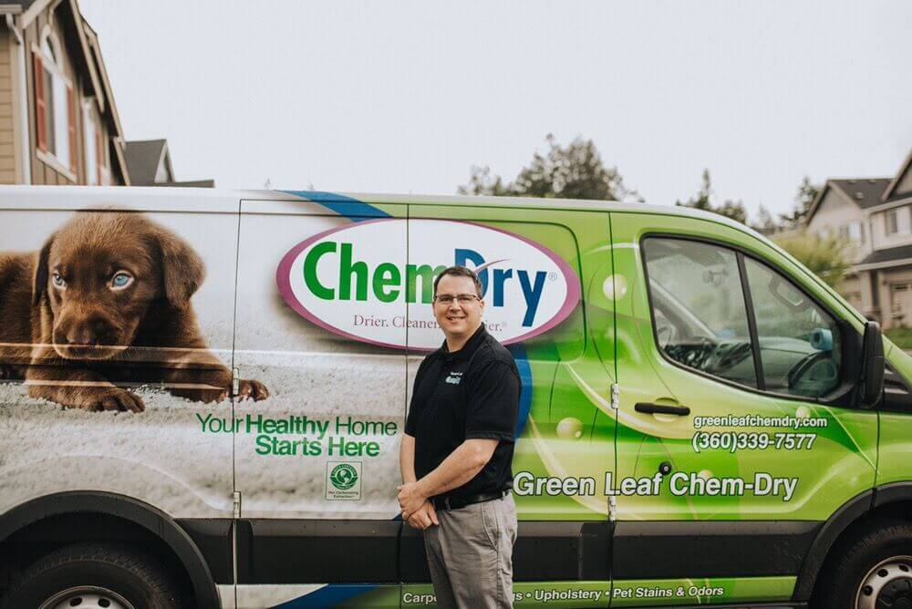 Jim Kilty, Owner of Green Leaf Chem-Dry, stands in front of our carpet cleaning van outside of our Olympia office.