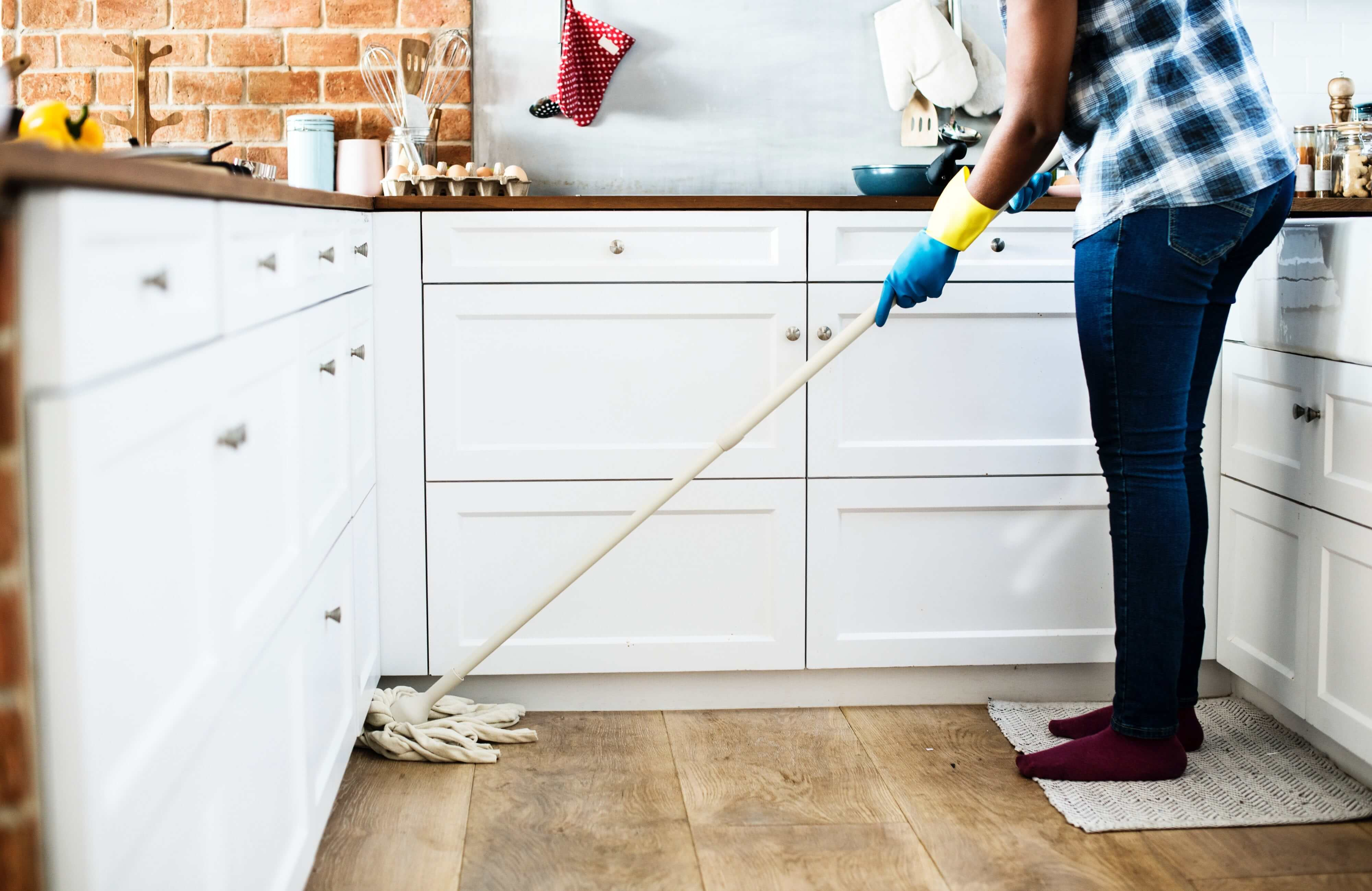 A woman mopping her kitchen floor