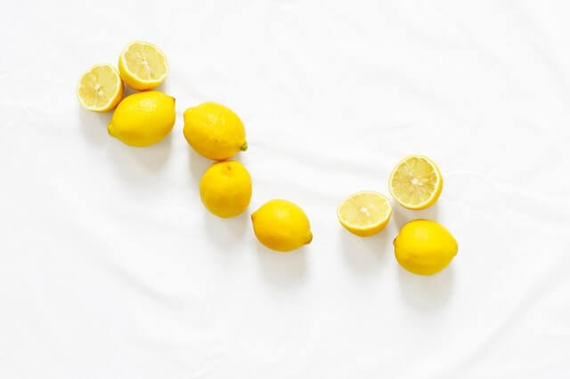 lemons rolling across a counter