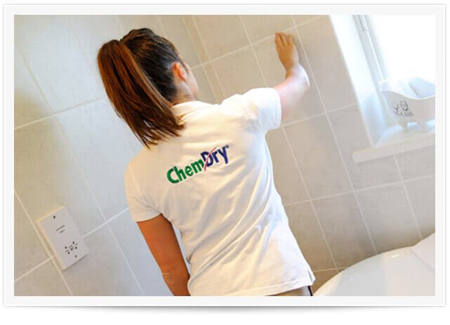 a chem-dry tile cleaner in yelm is scrubbing bathroom tiles clean.